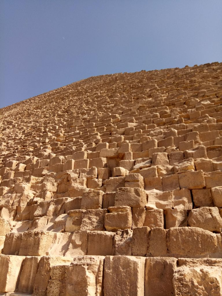 A view of the Great Pyramid Khufu from the base revealing all the stone structured into the mighty edifice.